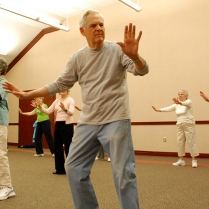 In this photo released by the University of Southern Mississippi, Hal Blackman of Hattiesburg, Miss., leads a Tai Chi class for senior adults Thursday at the Osher Lifelong Learning Institute on the University of Southern Mississippi campus in Hattiesburg. In addition to Tai Chi, the institute also offers a variety of classes such as painting and computer courses for its members. (AP Photo/University of Southern Mississippi, Steve Rouse)